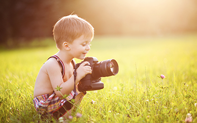 Child with a large camera