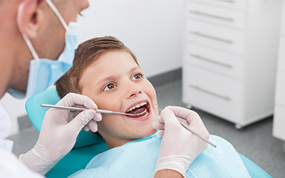 A young boy getting his teeth cleaned