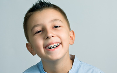 A young boy smiling with braces