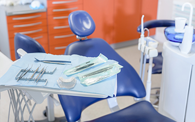 An empty dental chair and dental equipment